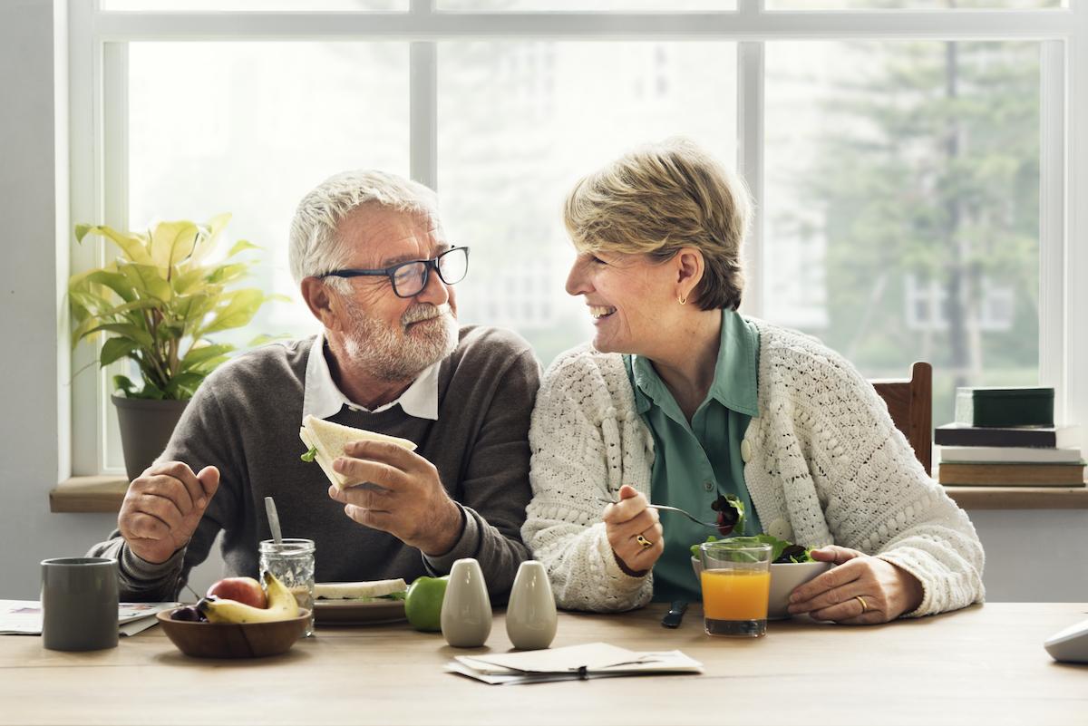 elderly couple eating together