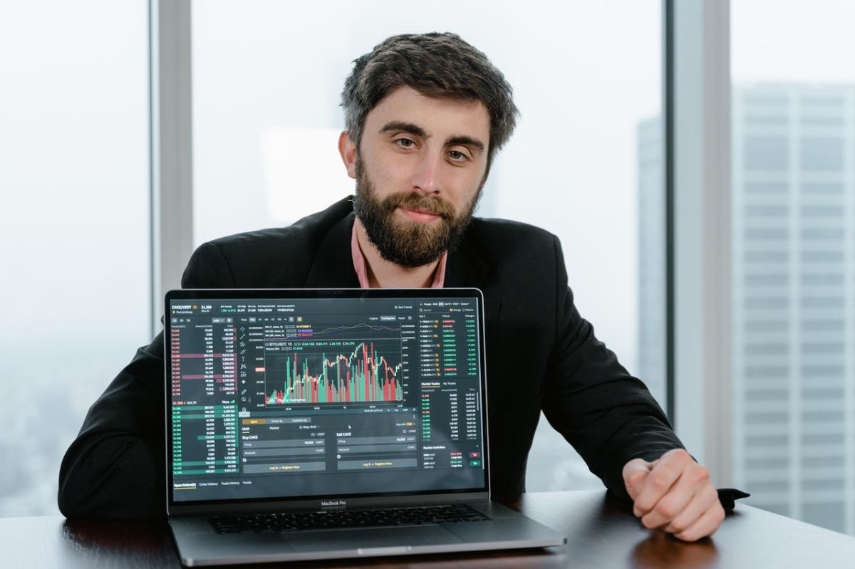 man showing graphs