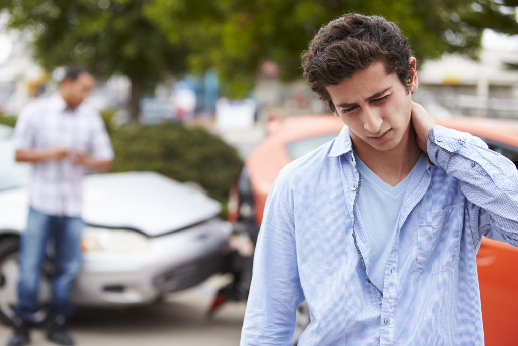 man aching from car accident