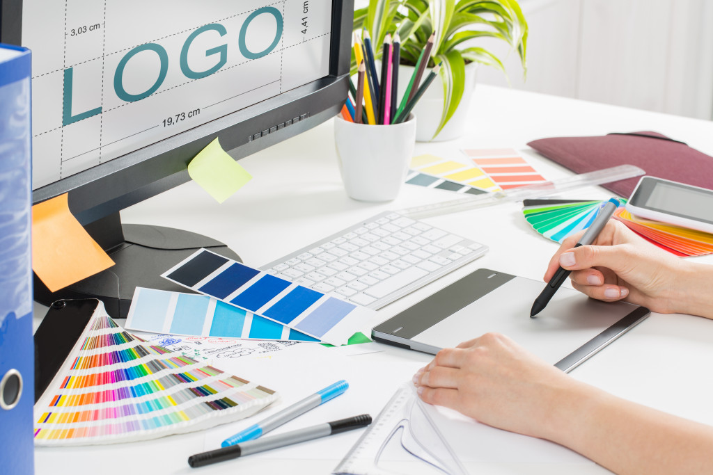 person creating a logo