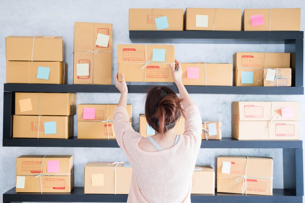 woman organizing boxes