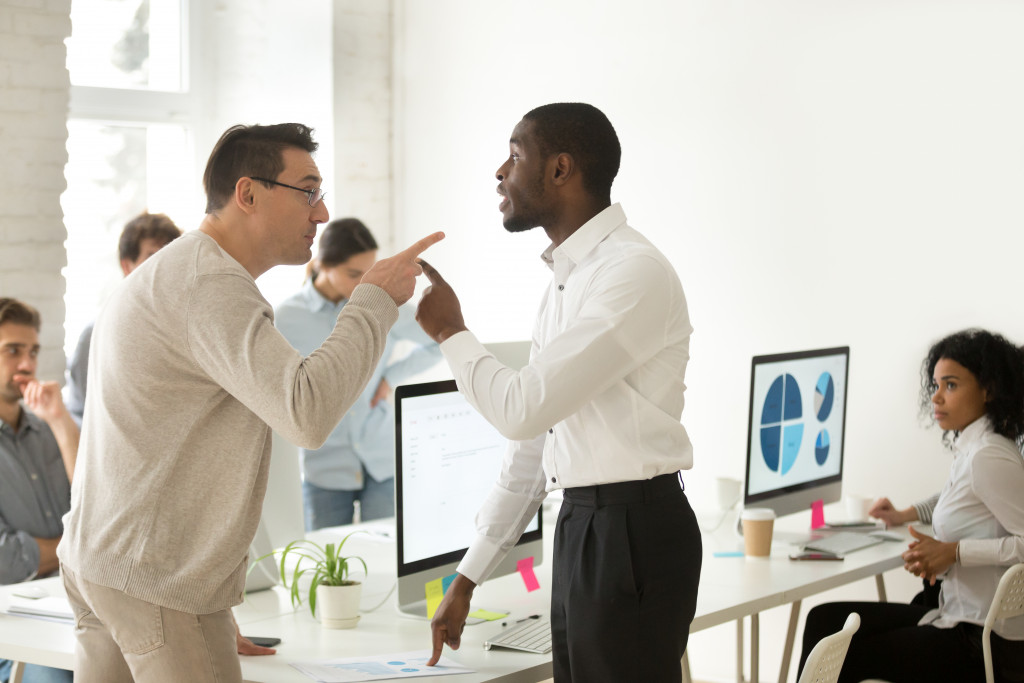 two employees arguing with each other