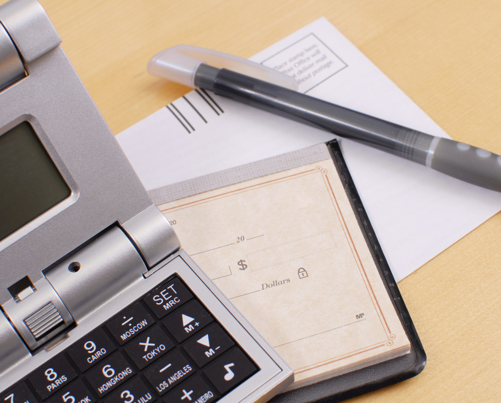 a calculator, pen, and cheque book