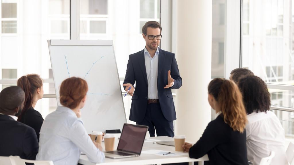 man speaking to employees