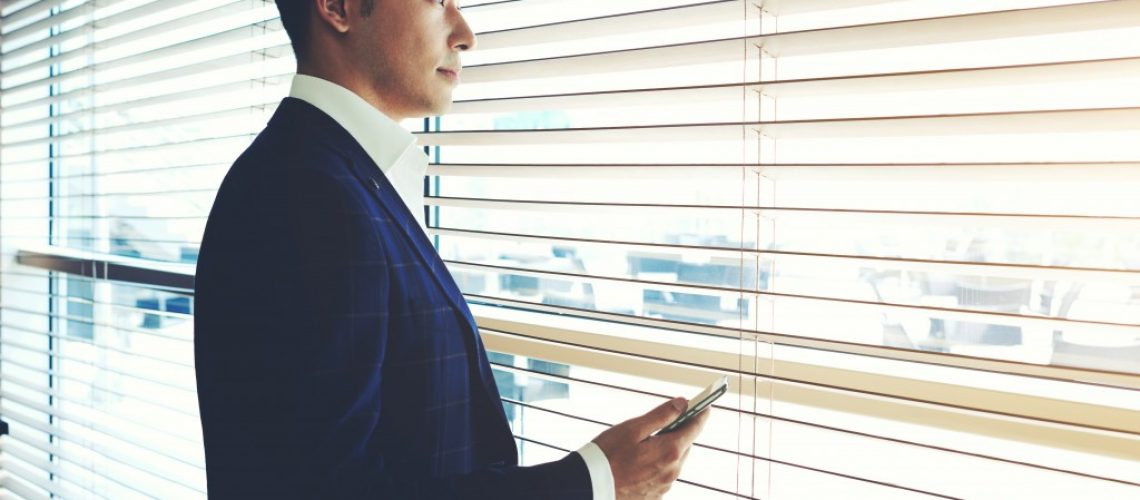 businessman looking out the window